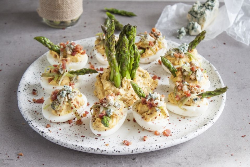 Deviled Eggs With Bacon, Roasted Garlic, Blue Cheese, and Asparagus